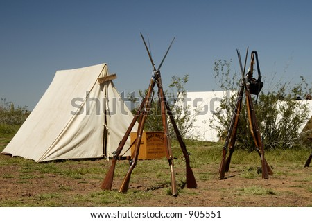 Tents and rifles in a civil war encampment. - stock photo