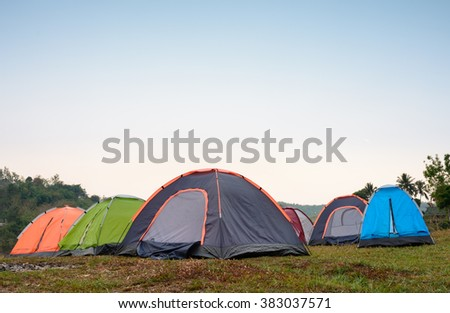 Tents at camping site during evening time - stock photo