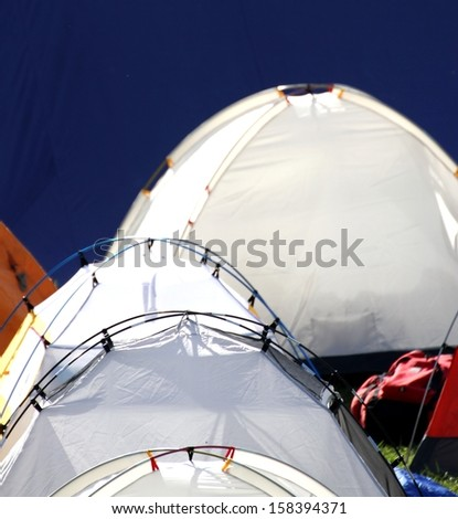 tents igloo for the adventurous expedition around the world and blue background - stock photo