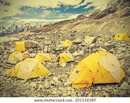 Tents in Everest Base Camp in cloudy day, Nepal, vintage retro style.  - stock photo