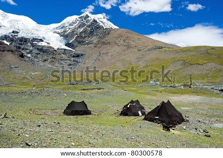 Tents in front of snow mountain (camping in nature) - stock photo