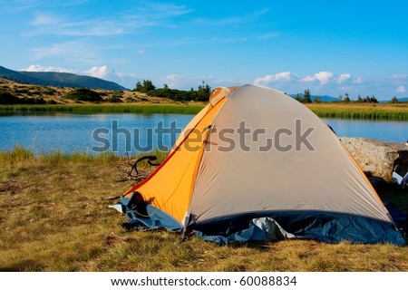 Tents in mountain - stock photo