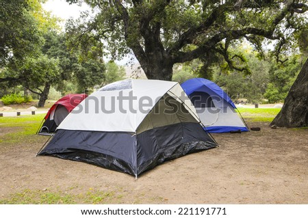 Tents ready for camping in California campground - stock photo