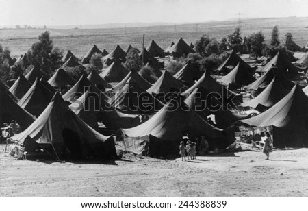 Tents used as temporary housing for Jewish immigrants in Israel. From 1948 to 1951, over 700,000 immigrants entered Israel, most were Holocaust survivors or Jews fleeing Arab lands. Ca. 1950. - stock photo