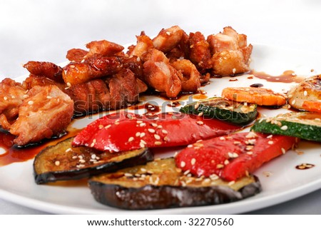 Tepan yaki meat and vegetables closeup - stock photo