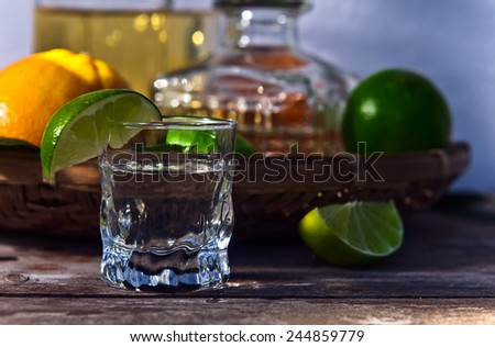 tequila and lime on a old table - stock photo