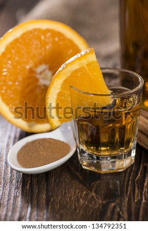 Tequila Gold with Cinnamon on wooden background