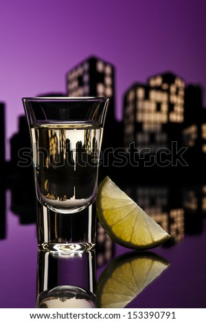 Tequila shoot in colorfull cityscape setting