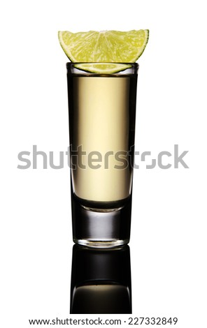Tequila shot with lemon in a mirror isolated on white background - stock photo