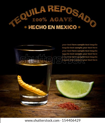 Tequila shot with lime and salt on vintage background. - stock photo