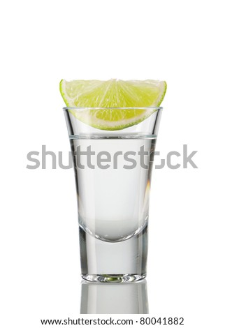 Tequila shot with lime isolated on white - stock photo