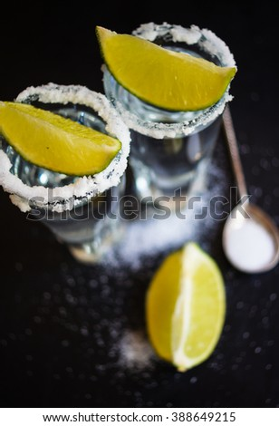 Tequila shot with lime . Selective focus - stock photo
