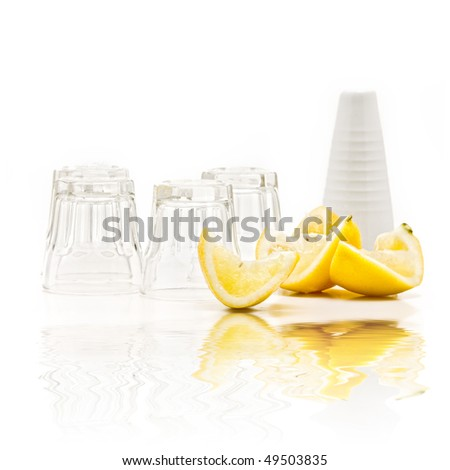 tequila shots on a bar with lemon and reflection - stock photo