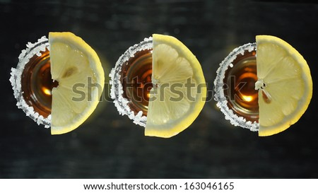 Tequila shots with lemon slice, top view - stock photo