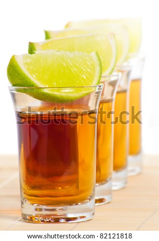Tequila shots with lime - stock photo