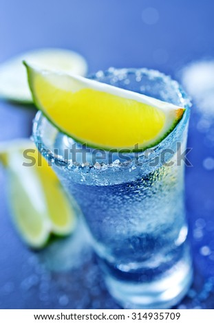 tequila shots with lime fruits