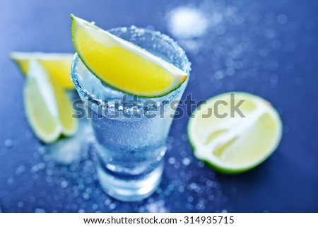 tequila shots with lime fruits  - stock photo