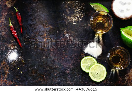 Tequila shots with lime slice and chili pepper, top view - stock photo