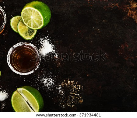 Tequila shots with lime slice, top view - stock photo