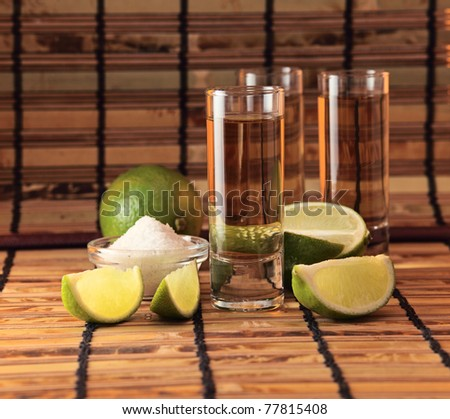 tequila with salt and lime. - stock photo