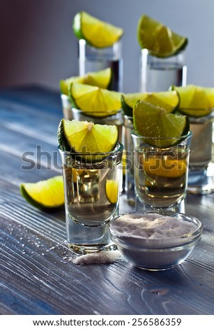 tequila with salt and lime on old wooden table