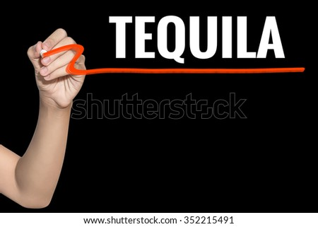 Tequila word write on black background by woman hand holding highlighter pen - stock photo