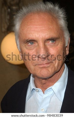 TERENCE STAMP & date at the world premiere of his new movie The Haunted Mansion. November 23, 2003  Paul Smith / Featureflash