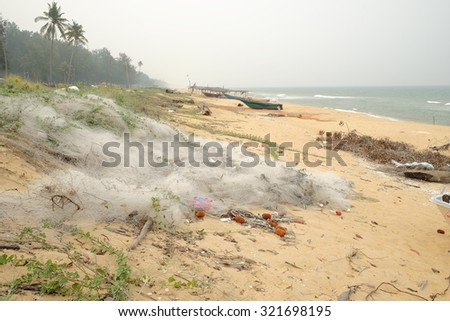 Terengganu, Malaysia - 28 Sep 2015 : Beach pollution with fishing net and rubbish eyesore in several coastal areas - stock photo