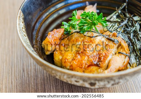 Teriyaki chicken on rice - stock photo