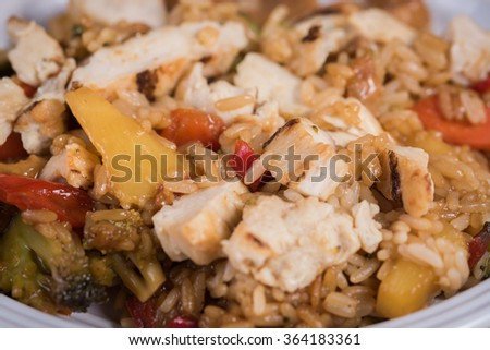 Teriyaki Chicken up close with pineapple, rice and broccoli.