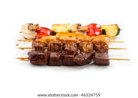 Teriyaki set with beef, chicken, salmon and vegetables - stock photo