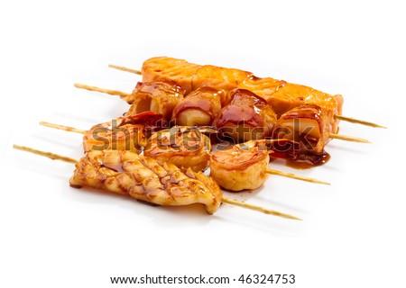 Teriyaki set with squid, tiger prawn, eel and bacon, salmon - stock photo