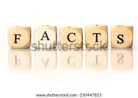 Term Facts spelled from toy cubes, dice letters with reflection on bottom. Studio shot on White background. - stock photo