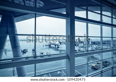 terminal outside,airport in the rain - stock photo