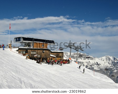 Terminal station of the cable car in alps - stock photo