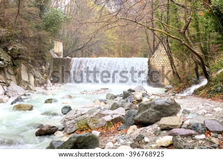 Termopotamos River. Cascade of artificial waterfalls on the mountain Voras by the thermal source - stock photo