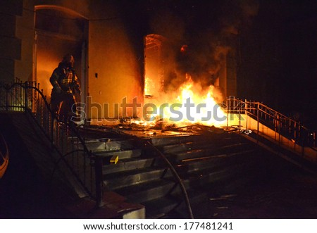 TERNOPIL, UKRAINE- FEBRUARY 18: Sturm of police department by activists Ukrainian revolution on February 18, 2014 in Ternopil, Ukraine. Protestants burned police department, overturned police cars.