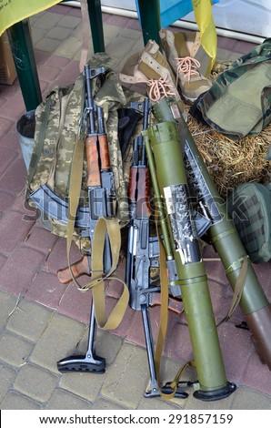 "Ternopol, Ukraine -June 28, 2015.  Kalashnikov automatic rifle AKS-47  7,62mm, RPG-26 ""Aglen"" is a disposable anti-tank rocket launcher, Military protective gear Ukrainian army. - stock photo"