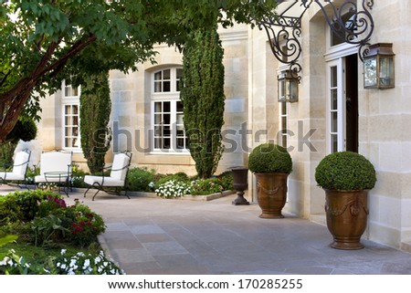 Terrace and garden of a French mansion near Bordeaux - stock photo