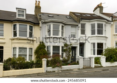 terrace at Brighton, view of a row of old houses on an uphill street in touristic sea town,  Brighton, East Sussex  - stock photo