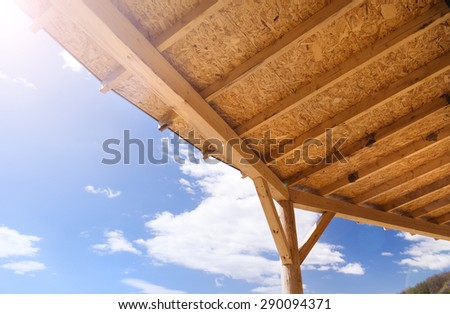 Terrace ceiling in an unfinished, ecological house and building area - stock photo