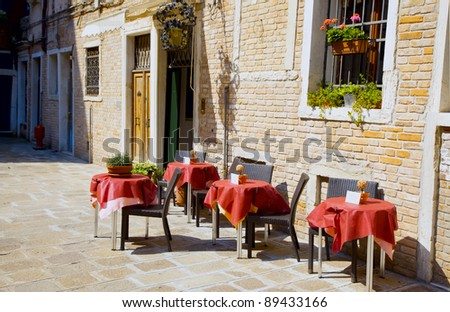 Terrace in the sun in front of a cafe - stock photo