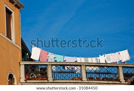 Terrace in Venice with laundry drying on a rope