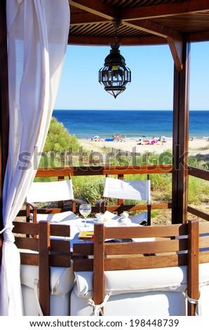 terrace lounge with pergola at  beach - stock photo
