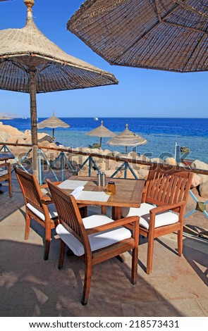 Terrace of a restaurant with sun shades on a beautiful Red sea beach, Egypt - stock photo