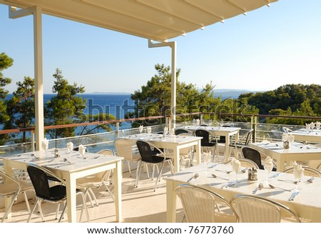 Terrace of a restaurant with view on the sea - stock photo