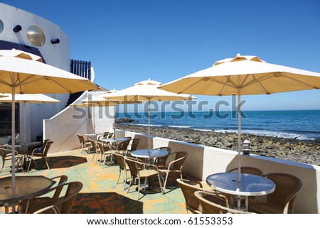 Terrace of a restaurant with yello sun shades on a beautiful taiwan beach - stock photo