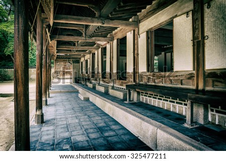 Terrace of one of the old traditional buildings in Changdeokgung Palace, Seoul, South Korea. Vintage style
