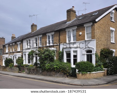 Terrace of 19th century English Victorian period town houses, UK. - stock photo