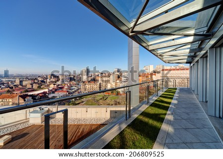 Terrace with metal and glass construction in modern building - stock photo